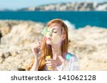 beautiful woman standing at the ... | Shutterstock . vector #141062128