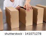worker working with boxes at... | Shutterstock . vector #141071278