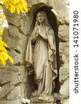 statue in cemetery at fall - stock photo