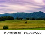 Landscape scenic view of Cades Cove Valley under cloudy skies in Tennessee