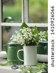 A Small Bouquet Of Lilies Of...