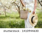 girl in white dress holding hat ... | Shutterstock . vector #1410944630