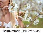 girl holding a branch of cherry ... | Shutterstock . vector #1410944636