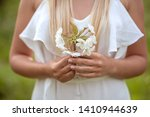 girls arms holding a branch of... | Shutterstock . vector #1410944639