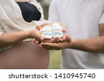 happy pregnant couple holding... | Shutterstock . vector #1410945740