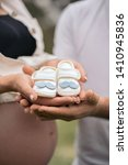 happy pregnant couple holding... | Shutterstock . vector #1410945836