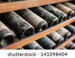 ancient wine bottles dusting in ...