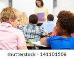 two pupils talking in class...   Shutterstock . vector #141101506