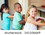 Stock photo elementary pupils collecting healthy lunch in cafeteria 141106669