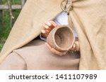 Woman Viking Sculpts Clay Pot....