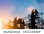 Small photo of Silhouette of engineer and construction team working at site over blurred background for industry background with Light fair.