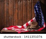 classic cowboy hat lasso and... | Shutterstock . vector #1411351076