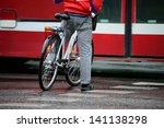 Man on bike, waiting, in traffic - stock photo