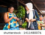 African Lady Selling Vegetable...