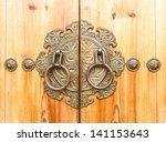 Ancient Door Knocker On A...