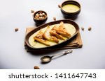 shahi tukra tukda or double ka...   Shutterstock . vector #1411647743