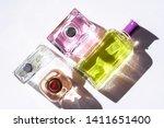 unisex perfume bottles on white ...   Shutterstock . vector #1411651400