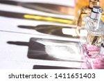 unisex perfume bottles on white ...   Shutterstock . vector #1411651403