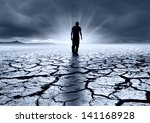 A troubled young man walking into the light - stock photo