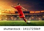 Soccer Player Kicks A Ball....