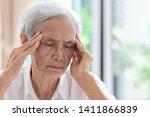 Asian Senior Woman Has Headache ...