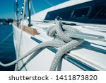 rope tied down to yacht or boat ... | Shutterstock . vector #1411873820