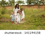 happy mother with three... | Shutterstock . vector #141194158