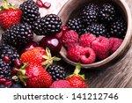 tasty summer fruits on a... | Shutterstock . vector #141212746