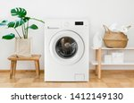 Stock photo clothes washing machine in laundry room interior 1412149130