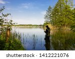 angler catching the fish during ... | Shutterstock . vector #1412221076