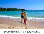 Surfing at Hikkaduwa beach Sri Lanka