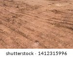 Soil and gravel and wheel prints on engineering land