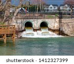 The water flows through the culverts in Elk Rapids Michigan on the way to Lake Michigan