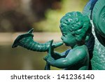 a green cherub statue playing a ... | Shutterstock . vector #141236140