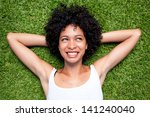 Happy Mixed Race Woman Lying...