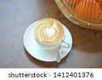 a cup of hot latte art coffee... | Shutterstock . vector #1412401376
