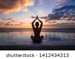 Woman Doing Yoga Against The...
