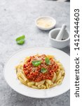 italian penne pasta with... | Shutterstock . vector #1412444603