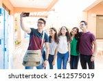 teenage boy taking selfie with... | Shutterstock . vector #1412575019