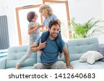 father playing with his children | Shutterstock . vector #1412640683