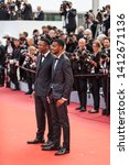 """Small photo of CANNES, FRANCE - MAY 21, 2019: Chris Tucker and Destin Christopher Tucker attend the screening of """"Once Upon A Time In Hollywood"""" during the 72nd annual Cannes Film Festival"""