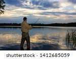 angler catching the fish during ... | Shutterstock . vector #1412685059