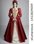 Small photo of Dark-haired Tudor woman in red dress