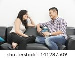 yound and happy chinese couple... | Shutterstock . vector #141287509