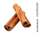 Small photo of Cinnamon sticks isolated on white background without shadow