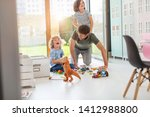 father playing with his... | Shutterstock . vector #1412988800