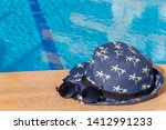 hat with palm trees and trendy...   Shutterstock . vector #1412991233