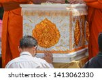 men are holding a coffin in... | Shutterstock . vector #1413062330