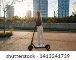 young beautiful woman riding an ... | Shutterstock . vector #1413241739