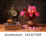 roses in a ceramic vase and... | Shutterstock . vector #141327289
